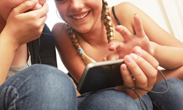 Girls using smartphone